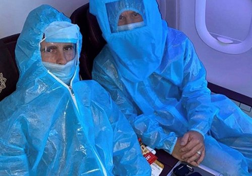 Kane Williamson and David Warner in full PPE on a connecting flight during the IPL